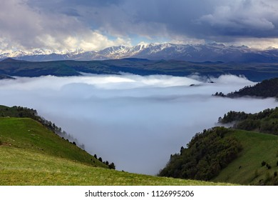 Mountain valley in the fog. The region of Elbrus, Karachay-Cherkessia, Russia. The gorge of the Malka River, the Gyly-Su tract.