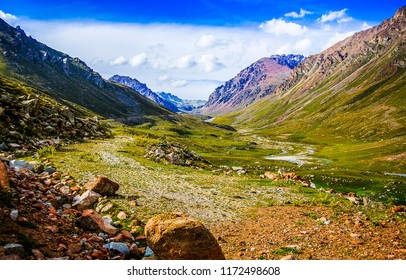 Mountain valley landscape. Mountain rocks in mountain valley panorama. Mountain valley view