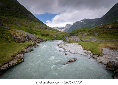 Mountain valley river in calm scenery Norway