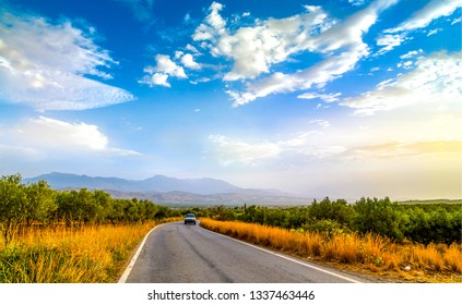 Mountain valley road landscape. Valley road car scene. Mountain valley road car trip. Asphalt road in mountain valley