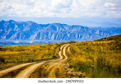 Mountain valley rural road landscape. Road in mountain valley. Mountain road in valley - Shutterstock ID 1987999553