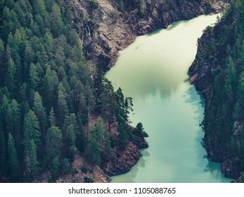 mountain valley with turquoise colored glacial stream