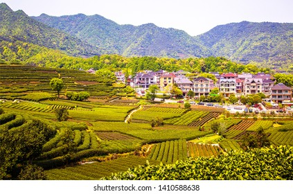 Mountain valley village farm fields landscape. Mountain village view. Mountain farm field at mountain village valley
