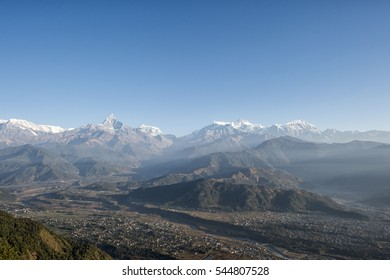 Mountain view after sunrise with natural light and layer from Sarangkot, Pokhara, Nepal.