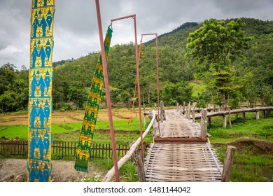 Mountain view and beautiful landscape bamboo bridge,Boon Bridge or Kho Koo So over rice fields in outdoor green nature in the valley,travel in Pai,Chiang Mai,Thailand