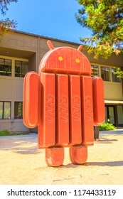 Mountain View, CA, United States - August 13, 2018: Android kitkat statue at Google's Merchandise Store and Google Visitor Center Beta. Android lawn are a popular place for selfies. Vertical shot
