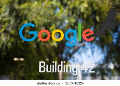 Mountain View, CA / USA - August 5, 2018: Logo Google on the glass door of Googleplex, the global corporate headquarters complex of Google and its parent company Alphabet Inc.