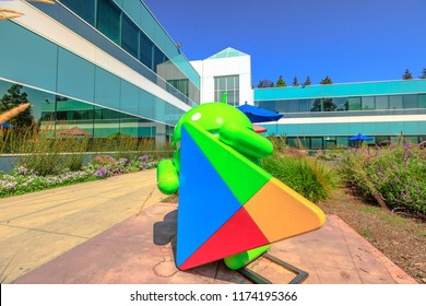 Mountain View, California, United States - August 13, 2018: Android Nougat statue on foreground at Charleston Campus of Google Headquarters in Silicon Valley near Googleplex. Building 47.
