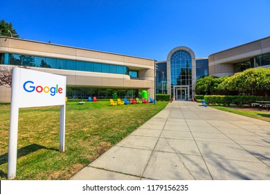 Mountain View, California, United States - August 13, 2018: Google Sign on 1625 Charleston road at Campus of Google HQ in Silicon Valley near Googleplex. Google android Nougat on background