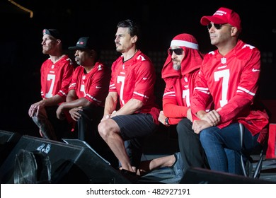 Mountain View, CA/USA - 9/13/16: Prophets of Rage wear San Francisco 49er Colin Kaepernick jerseys. The band took a knee to while the national anthem played before the show.