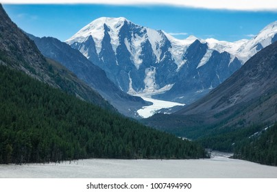 Mountain view of Maashey-Bash Peak and Maashey Glacier Snow field in evening. Disappeared lake Maashey. North-Chuya Ridge in Altay.