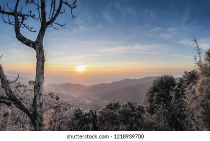 Mountain view morning above Pang Tong Palace and top hill around with soft mist with colorful of sun light in the sky background, sunrise at Pang Tong View Point, unseen Mae Hong Son, Thailand.