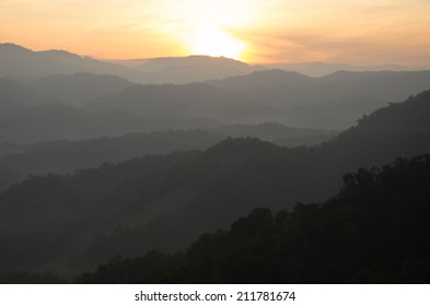 Mountain view in the morning with mist and golden light in North part of Thailand