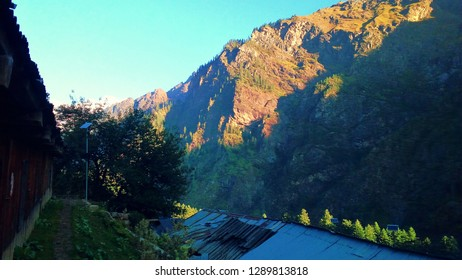 Mountain view with natural green trees and evening sunset light on mountain. This image is from Kasol, Himachal Pradesh, India.