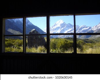 A mountain view out of a cabin window