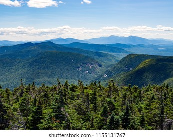 Mountain view overlook forest covered hills in the Mahoosuc Range of the Appalachian Mountains in Maine.