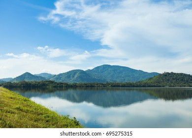 The mountain view with reservoir and blue sky in the background. fresh green mountain pastures with mountain in Nakorn Nayok,Thailand