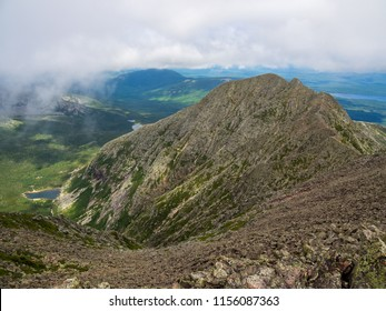 Mountain view, rocky slopes and lush valley below.  The Knife's Edge on Katahdin, Baxter State Park, Maine.