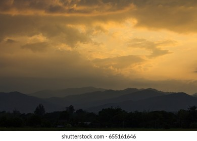 Mountain view and sunset sky.