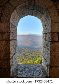 Mountain view through the arch of the old tower.