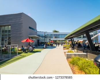 Mountain View, USA - September 25, 2018: Employees walking outdoors at Googleplex headquarters main office