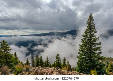 Mountain view of valley with mist and clouds