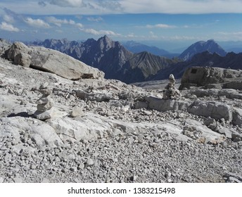 Mountain view at the Zugspitze with a bench and little rock hills on a sunny day, europe, germany, bavaria, Zugspitze