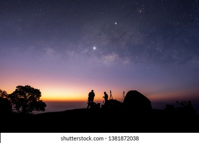 The mountain viewpoint has stars and the Milky Way in the night sky.