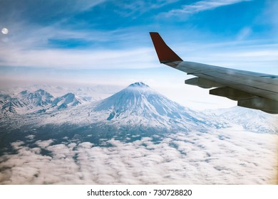 Mountain views of Kamchatka from the window of the plane