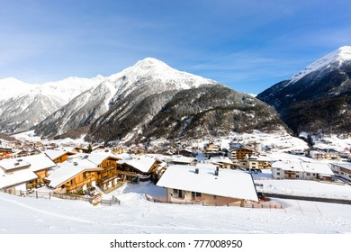 The mountain village at the Austrian ski resort Soelden on a cold and sunny winter day.