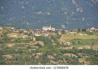 The Mountain Village of Lens in the Valais canton of Switzerland perched on a ridge