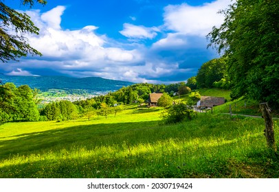 Mountain village on the green hills. Village in mountains. Rural summer landscape. Countryside summer landscape in mountains