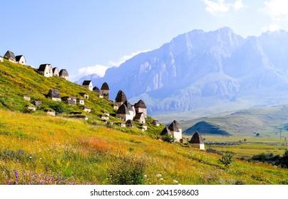 Mountain village on a mountain slope. Village in mountains. Mountain village ruins. Mountain village cabins