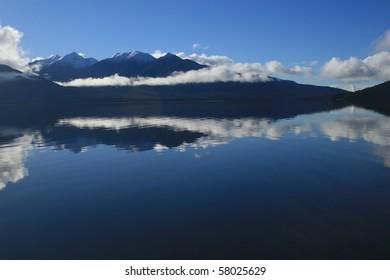 Mountain vista across Lake Manapouri, Fiordland National Park, New Zealand