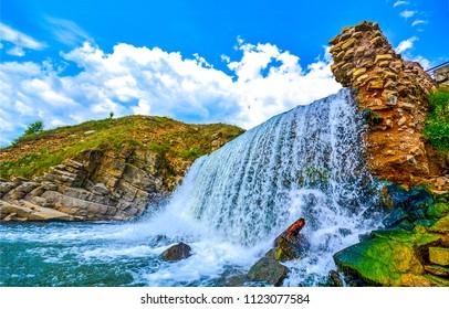 Mountain waterfall landscape. Waterfall mountain view. Mountain waterfall scene