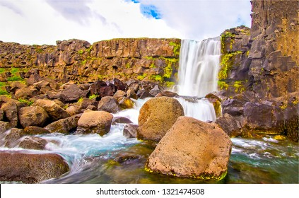 Mountain waterfall rocks ladscape. Waterfall mountain view. Waterfall rocks in mountains. Mountain waterfall rocks view
