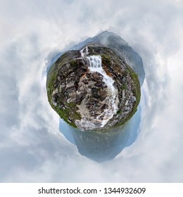 Mountain waterfall stream in misty rainy weather in the valley. Tiny little planet 360