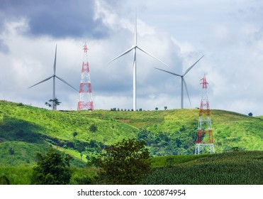 Mountain wind turbines and electric power towers. The clean electrical energy system in Khao Kho District, Phetchabun, Thailand, Southeast Asia.