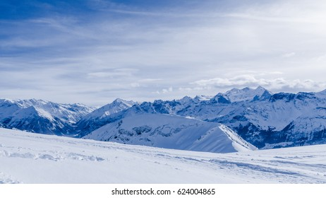 mountain in winter, covered of snow.  turns in a sunny day