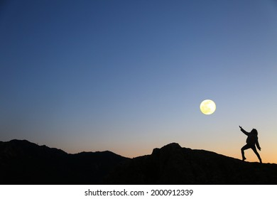 mountain woman silohuette and moon in the sky
