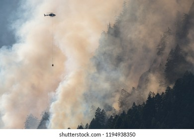 Mountain wood fire with Fire department helicopter
