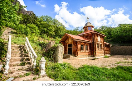 Mountain wooden church summer landscape. Summer mountain church view. Mountain church scene. Wooden church in mountains