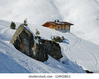 A mountain wooden hut covered with fresh snow in Zillertal, Austria