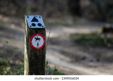 Mountainbike sign next to a mountainbike path. Horses and pedestrians not allowed. Mountainbikers allowed in national park Loonse en Drunense Duinen, near Loon op Zand, Noord Brabant, Netherlands.