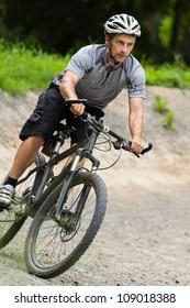 Mountainbiker driving through a curve