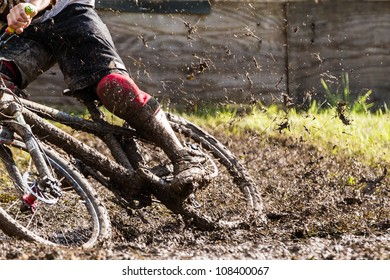 mountainbiker with a lot of mud