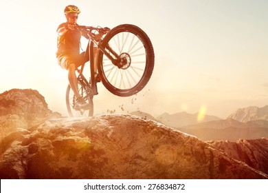 Mountainbiker performs a Wheelie