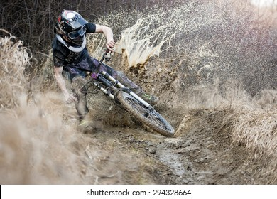 Mountainbiker rides on path in mud