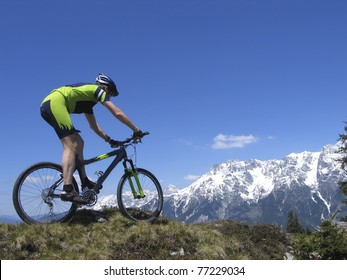 Mountainbiker riding the Alps