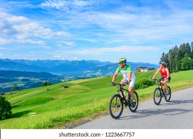 Mountainbikers doing a tour in the alps